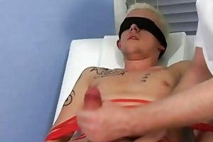 bound and blindfolded golden-haired twink gets