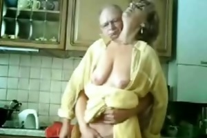 mom and daddy having fun in the kitchen. stolen