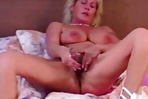 old blond whore playing with toy