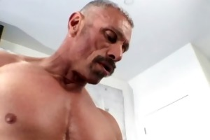 old muscleman lets a huge dark shaft up his a-hole