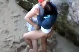 youthful couple fuck at the beach