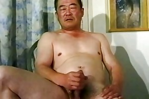 old asian lad stroking his penis untill cumming