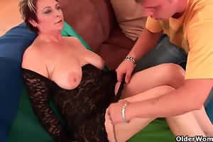 sexy grandma enjoys his cock in her mouth and