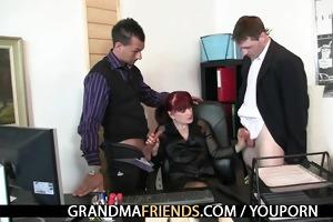 aged office whore enjoys two jocks