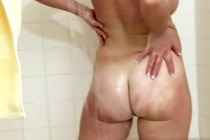 her own cum trickling from her mature snatch