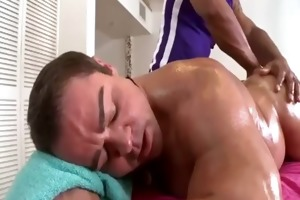 muscled daddy naked as athletic masseur strokes