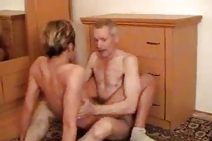 blond fellow enjoys jumping on old farts cock