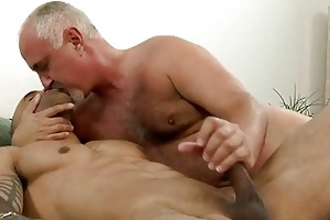 hot tattooed gay giving handjob to his older dad