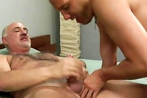aged homosexual gives younger hunk a handjob on