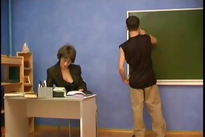 teacher puts her hand into a youthful boys pants