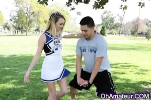 sexually excited young blonde cheerleader