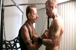 aged leather daddies fuck in a sling