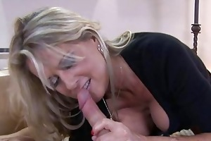 blonde milf with large breasts sucks younger