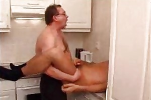 man in glasses rimming his younger friend in the