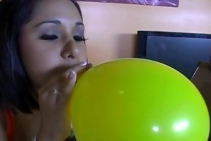 teen smokes cigarette and blows up balloons