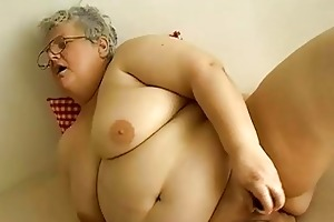 old chubby granny with big milk sacks plays with