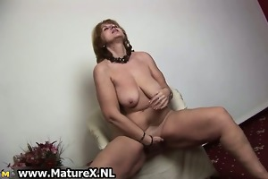 excited old housewife enjoys squeezing