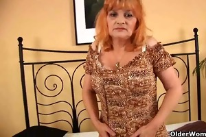redheaded granny with big tits sucks cock and